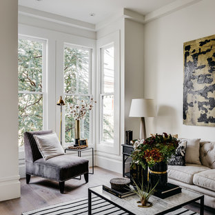 Example of a transitional light wood floor living room design in San Francisco with beige walls