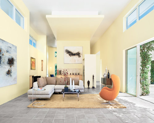 Living room design ideas renovations photos with terra cotta floors and yellow walls for Terracotta living room ideas