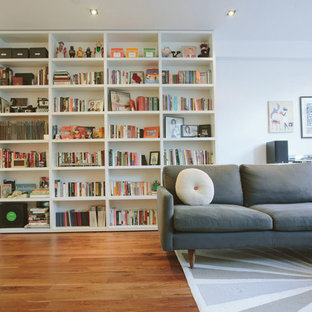 Living room - small contemporary open concept and formal medium tone wood floor living room idea in New York with white walls