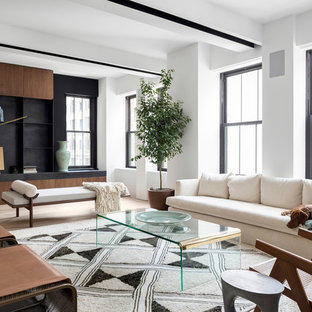 Inspiration for a large contemporary open concept and formal light wood floor living room remodel in New York with white walls and no fireplace