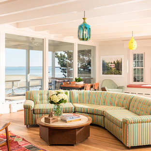 Inspiration for a coastal open concept light wood floor living room remodel in Boston with white walls