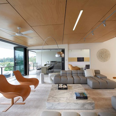 Large minimalist formal and open concept porcelain tile living room photo in Brisbane with white walls