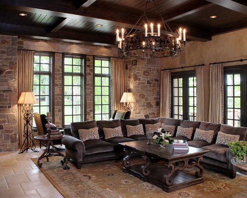 Example Of A Tuscan Living Room Design In Cleveland With Beige Walls