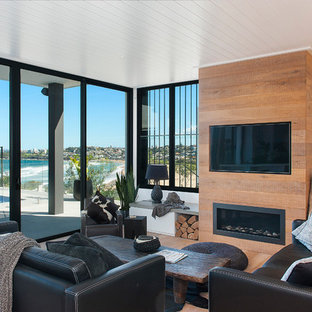 Inspiration for a contemporary living room in Sydney with white walls, medium hardwood flooring, a ribbon fireplace, a wooden fireplace surround and a wall mounted tv.