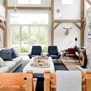 Inspiration for a huge cottage open concept light wood floor and brown floor living room remodel in New York with white walls, a standard fireplace and a brick fireplace