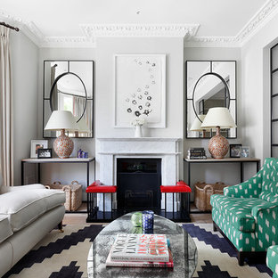 Inspiration for a transitional formal living room remodel in London with gray walls and a standard fireplace