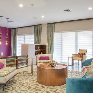 Esempio di un grande soggiorno boho chic aperto con sala formale, pareti viola, pavimento in gres porcellanato, nessun camino, nessuna TV e pavimento beige