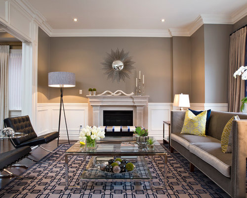 Contemporary Living Room In Toronto With Grey Walls And A Standard  Fireplace.