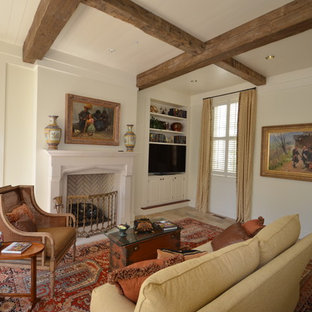Photo of a traditional living room in Atlanta with beige walls and a built-in media unit.
