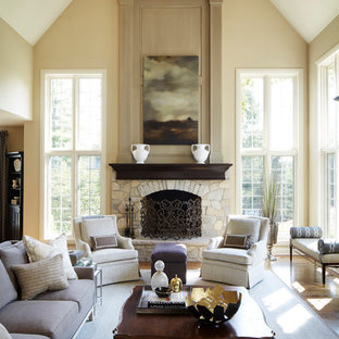 Elegant formal and open concept dark wood floor living room photo in Chicago with beige walls, a standard fireplace, a stone fireplace and no tv