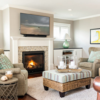 Mid-sized beach style open concept dark wood floor living room photo in Boston with a standard fireplace, a stone fireplace and a wall-mounted tv