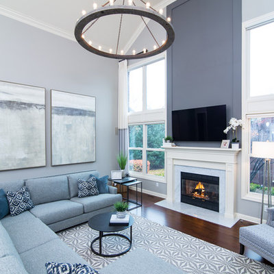 Inspiration for a mid-sized transitional open concept dark wood floor and brown floor living room remodel in Detroit with gray walls, a standard fireplace, a stone fireplace and a wall-mounted tv