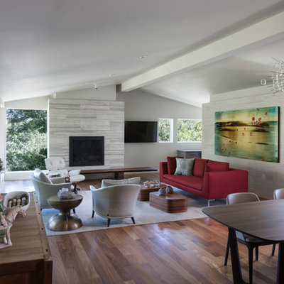Example of a mid-sized trendy formal and open concept dark wood floor living room design in Austin with gray walls, a standard fireplace and a stone fireplace