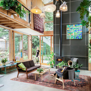 Example Of A Trendy Loft Style Concrete Floor Living Room Design In  Portland With A