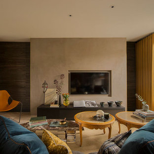 Contemporary living room in London with beige walls, a wall mounted tv and beige floors.