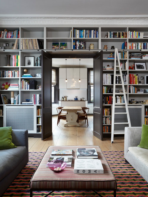 transitional living room library idea in london - Library Design Ideas