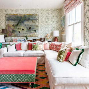 Photo of a medium sized eclectic enclosed living room in London with multi-coloured walls and multi-coloured floors.