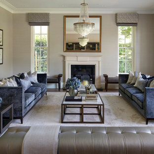 Medium sized contemporary formal enclosed living room in Berkshire with grey walls, dark hardwood flooring, a standard fireplace, no tv and brown floors.