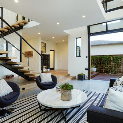 Inspiration for a contemporary concrete floor living room remodel in Los Angeles with white walls