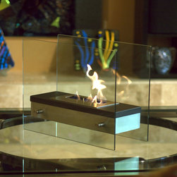"Bluworld - Nu-Flame Tabletop Ardore Ethanol Fireplace - Italian for ""fiery passion"", the elegant Ardore fireplace lives up to its name. A large capacity stainless steel burner is capped with a sleek black cover drawing attention to the dancing flames. The burner is suspended between two thick tempered glass panels which reflect and enhance the fire. Easily adjust the flame height or extinguish it completely with the provided dampener tool. Fuel not included, we recommend using Nu-Flame Bio-Ethanol Fuel. For indoor use only."