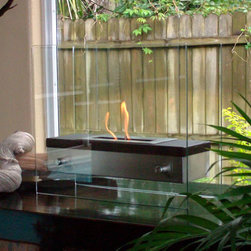 "Bluworld - Nu-Flame Tabletop Foreste Ardore Ethanol Fireplace - Italian for ""fiery passion"" the elegant Foreste Ardore fireplace lives up to its name. A large capacity stainless steel burner is capped with a realistic dark walnut wood finish cover drawing attention to the dancing flames. The beautiful walnut finish gives a traditional look and feel to an otherwide contemporary design. The burner is suspended between two thick tempered glass panels which reflect and enhance the fire. Easily adjust the flame height or extinguish it completely with the provided dampener tool. Fuel not included, we recommend using Nu-Flame Bio-Ethanol Fuel. For indoor use only. Foreste Ardore tabletop bio-fireplace may be used indoors or out, however do not leave your fireplace outside exposed to the elements after use."