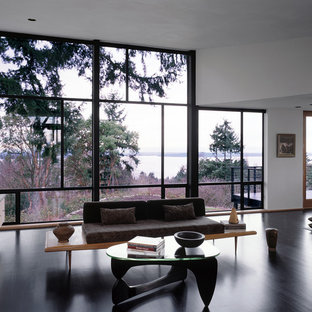 Example of a minimalist living room design in Seattle with white walls