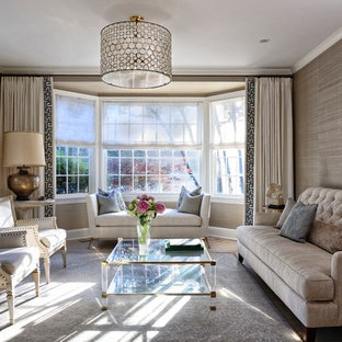 Example of a transitional living room design in DC Metro with gray walls
