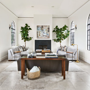 Tuscan gray floor living room photo in Portland with white walls and a standard fireplace