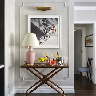 Example of a transitional dark wood floor living room design in New York with a bar and gray walls