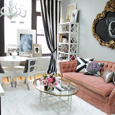 Inspiration for a small eclectic enclosed light wood floor living room remodel in Kansas City with no tv and gray walls