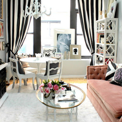 Inspiration for a small eclectic enclosed light wood floor living room remodel in Kansas City with gray walls