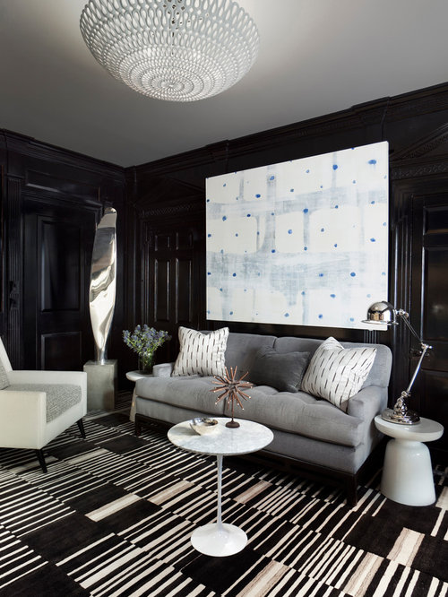 Transitional carpeted and multicolored floor living room idea in New York  with black walls