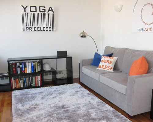 example of a small minimalist home yoga studio design in new york with carpet