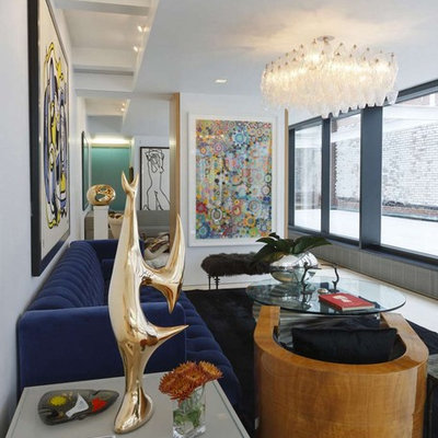Example of an urban living room design in New York with white walls