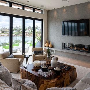 Esempio di un grande soggiorno moderno stile loft con sala formale, pareti beige, camino classico, cornice del camino piastrellata, parete attrezzata e pavimento beige