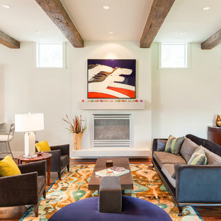 Example of a transitional formal and open concept medium tone wood floor living room design in Houston with white walls