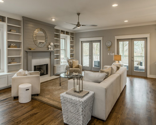 Example Of A Mid Sized Transitional Formal And Open Concept Medium Tone Wood Floor Living