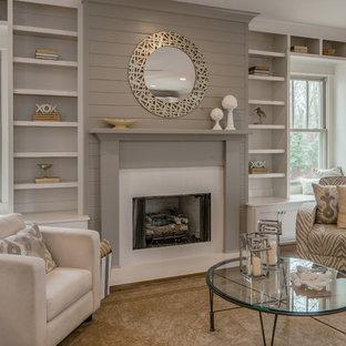 Imagen de salón para visitas abierto, clásico renovado, de tamaño medio, sin televisor, con paredes grises, suelo de madera en tonos medios y chimenea tradicional