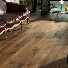 Rustic Living Room by Coswick Hardwood