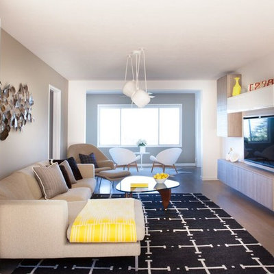 Inspiration for a mid-sized mid-century modern open concept light wood floor living room remodel in San Francisco with white walls, no fireplace and a wall-mounted tv