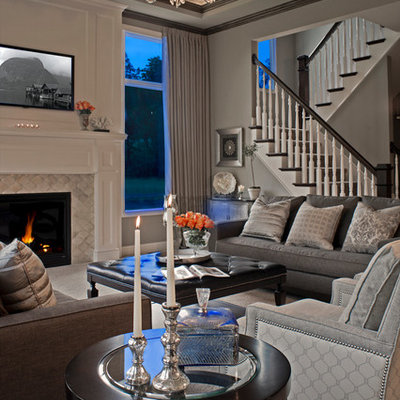 Inspiration for a large timeless formal and open concept carpeted living room remodel in Detroit with gray walls, a standard fireplace, a tile fireplace and a media wall