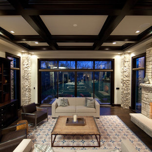 Example of a large trendy formal and open concept dark wood floor living room design in Chicago with beige walls, a standard fireplace, a stone fireplace and a wall-mounted tv