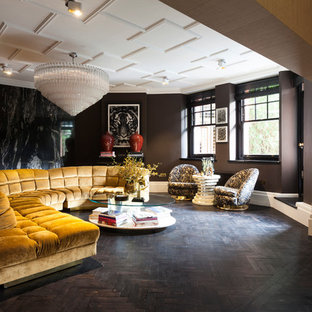Photo of a large contemporary formal open plan living room in London with brown walls and dark hardwood flooring.