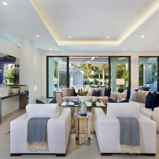 Modern living room in Los Angeles with white walls, a wall mounted tv and beige floors.