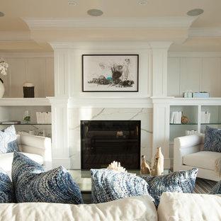 ロサンゼルスの中サイズのビーチスタイルのおしゃれなLDK (フォーマル、標準型暖炉、石材の暖炉まわり、白い壁) の写真