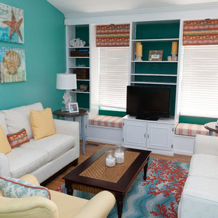 Example of a mid-sized island style medium tone wood floor and brown floor living room design in DC Metro with blue walls, a tv stand and no fireplace