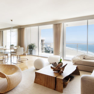 Example of a mid-sized trendy formal and open concept light wood floor living room design in Los Angeles with white walls, no fireplace and no tv