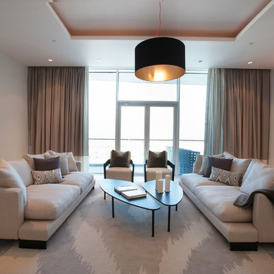 Example of a trendy living room design in Other with beige walls