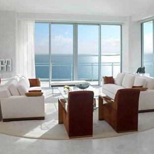 Esempio di un grande soggiorno minimal aperto con pareti bianche, pavimento in marmo, sala formale, nessun camino, nessuna TV e pavimento bianco
