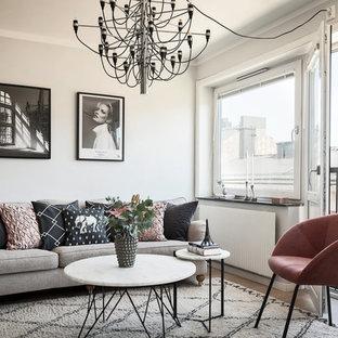 Inspiration för små minimalistiska vardagsrum, med grå väggar